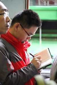Alfonso Yin of COFCO takes notes at Scott Fritz&#039;s farm during a recent visit.