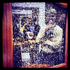 Bee keeper Veldon Sorenson looks on at the bee display during Commodity Classic.