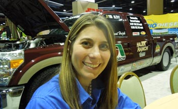 Jessica Robinson of the National Biodiesel Board with the pick-up land speed record holder (over 182 mph, on B20 biodiesel) at Commodity Classic, Kissimmee, Fla., March 1, 2013.