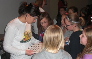 Catherine Ripp distributes 'farm animal' stickers to Gretna fourth graders.