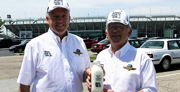 Rookie Milkman Ken Noe of Rushville, Ind. and Milkman Duane Hill of Fountain City, Ind. with the coveted glass bottle of milk for the winner of the Indy 500.