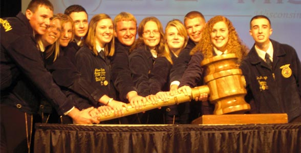 The new Wisconsin State FFA Officer Team brings the gavel down on the 84th annual State Convention.