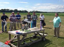 Donald Effren of AutoCopter Corp, far right, explains his UAV pre-flight before InfoAg Conference in central Illinois