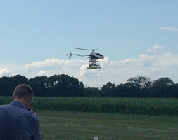 AutoCopter Corporation UAV coming in for landing, Holmes field, Pawnee, Illinois