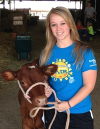 Gabrianna Gardner, Missouri Junior Holstein Association President, with 'Sprinkles' at the 2013 Missour State Fair