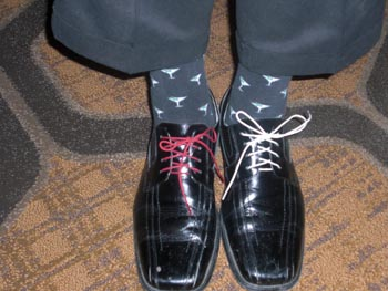 Shoes on the feet of Chris Novak, National Pork Board CEO