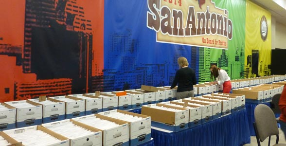 Pre-registrations await distribution at the start of Commodity Classic, San Antonio, Texas. Click photo for story