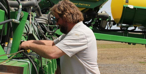 Brent Hostetler, Plain City, Ohio – going over the planter one more time