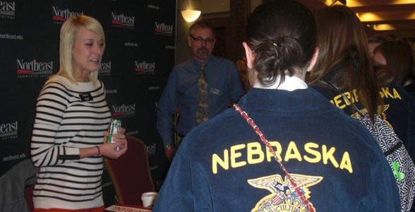 Joni Cassidy of Northeast Community College visits with prospective students at the Nebraska FFA Convention.