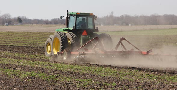 A central Illinois farmer works ground.