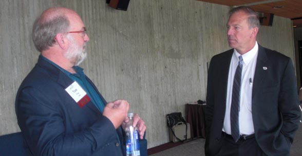 Iowa Farm Bureau Federation president Craig Hill (right) visits with futurist Tom Frey of the DaVinci Institute at the IFBF Economic Summit in Ames.