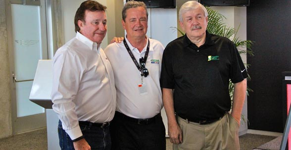 Richard Childress of Richard Childress Racing, Tom Buis of Growth Energy, and Ken Parrent of the Indiana Corn Marketing Council celebrate NASCAR running 6 million miles on E-15.