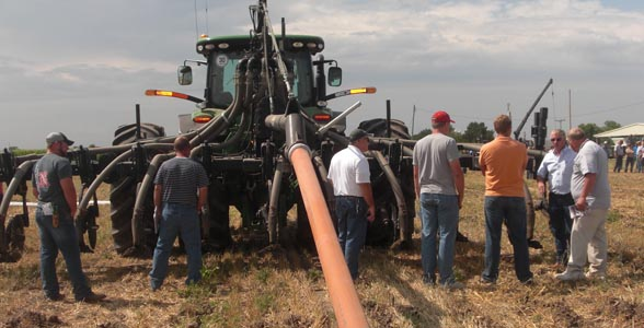 Farmers inspect a continuous flow drag line system during Nebraska Manure Demonstration Day in Lexington.