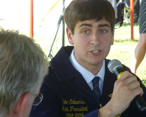 Missouri FFA President Cole Edwards, Salisbury, addresses Gov. Nixon during a roundtable discussion at the State Fair, Aug. 13, 2014.