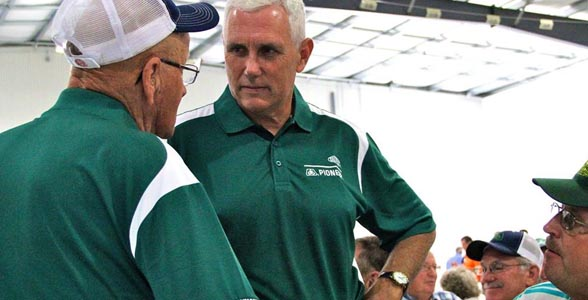 Indiana Governor Mike Pence talks to farmers at the Plymouth, Ind. Pioneer Production facility's 25th Anniversary open house.