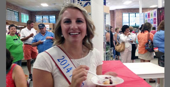 Missouri State Fair Queen Ashley Bauer enjoying prize-winning pie at the Missouri State Fair.