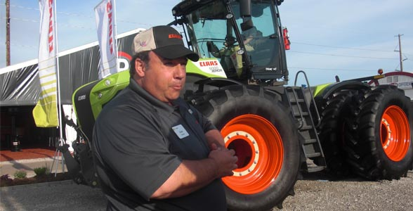 At the Farm Progress Show, Drew Fletcher of CLAAS promotes the company's new XERION tractor.