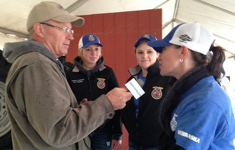 Ken Anderson interviews Stacey Agnew, while state FFA officers Amanda Lambrecht and Blair Hartman look on.