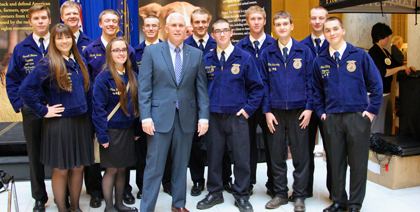 Indiana Governor Mike Pence poses with FFA members during the Protect the Harvest meet and greet at the Statehouse.